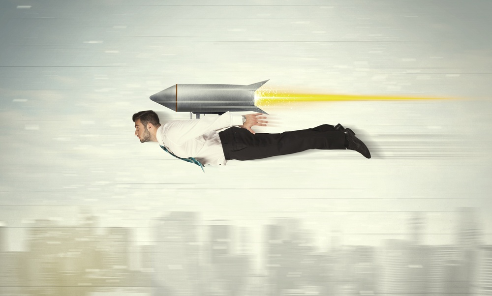 Superhero business man flying with jet pack rocket above the city concept